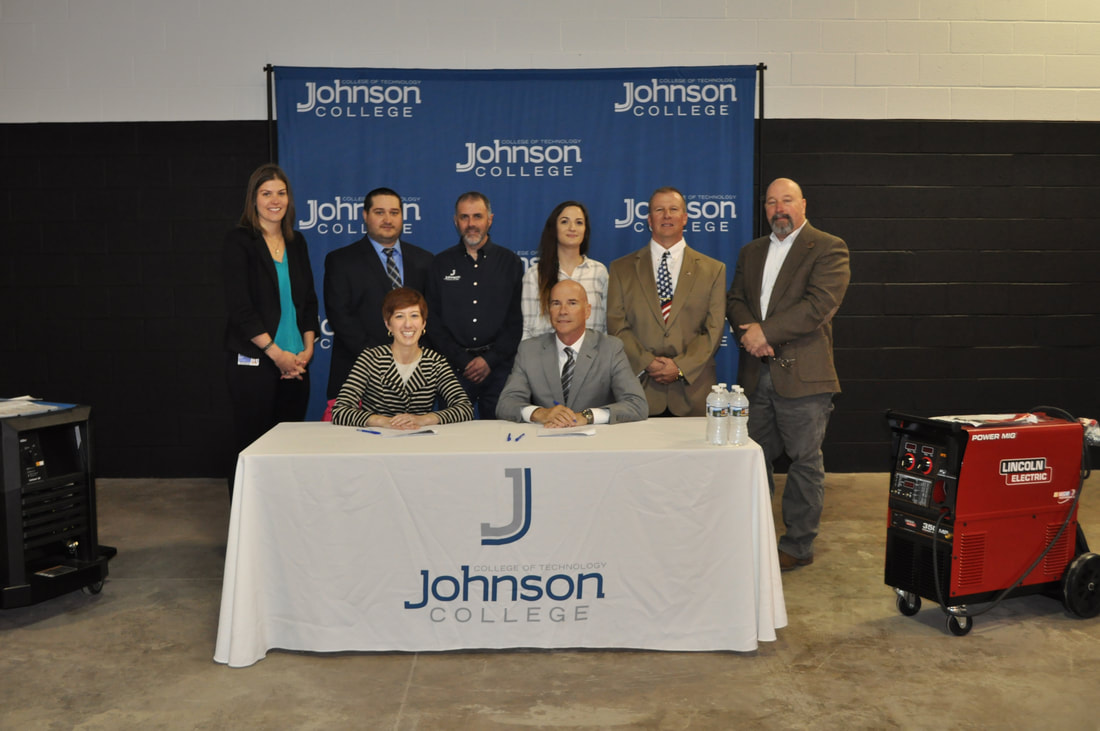 Signing at Johnson College